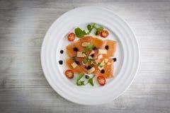 Salmon carpaccio on plate Royalty Free Stock Image