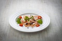 Salmon carpaccio on plate Stock Photos