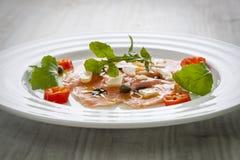 Salmon carpaccio on plate Royalty Free Stock Photos