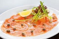 Salmon carpaccio Royalty Free Stock Image