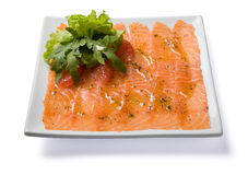 Salmon carpaccio served on white plate. Stock Photos