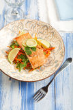 Salmon with Carrot Slaw. Asian influenced Salmon and carrot slaw Stock Photo