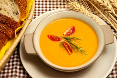 Salmon and carrot soup. With sesame bread Stock Photography