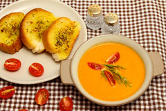 Salmon and carrot soup. With sesame bread Stock Photo