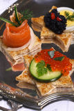 Salmon and caviar canape royalty free stock photography