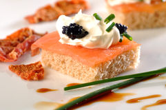 Salmon and caviar canape. On plate royalty free stock image