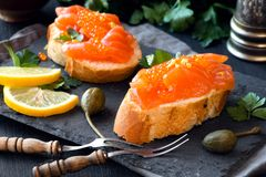 Salmon and caviar canape on a slate board Stock Images