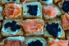 Salmon and caviar canapes. Detail photo of salmon canapes and caviar royalty free stock photos