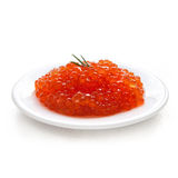 Salmon caviar on a ceramic plate Royalty Free Stock Photos
