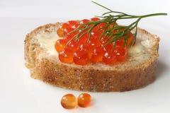 Salmon caviar on fresh whole-grain baguette Royalty Free Stock Photography