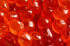 Salmon caviar on a full background close-up. horizontal Royalty Free Stock Photos