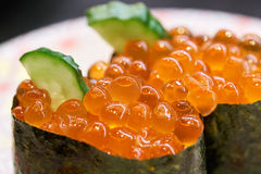Salmon and caviar rolls served on a plate Royalty Free Stock Photography