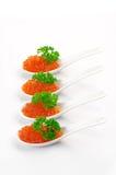 Salmon caviar in spoons Royalty Free Stock Photos