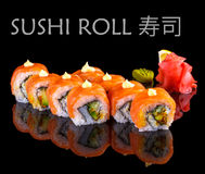 Salmon and caviar sushi roll on black Stock Photo