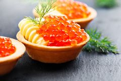 Salmon caviar. Tartlets with red caviar. Gourmet food. Seafood. Trout caviar Stock Images