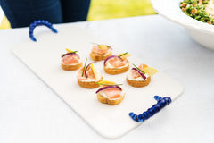 Salmon ceviche canapes. With apple slices and fresh chives Stock Photo