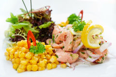 Salmon ceviche with corn and herbs Stock Photo