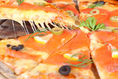 Salmon cheese pizza to eat stretch. Salmon Pizza great Tray is cut into ready to eat Stock Photo
