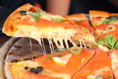Salmon cheese pizza to eat stretch. Salmon Pizza great Tray is cut into ready to eat Royalty Free Stock Photo