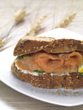Salmon and cheese sandwich. A salmon and cream cheese sandwich made of whole grain bread royalty free stock photo