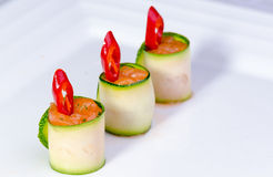 Salmon chili finger food. Fancy salmon and chili wrapped in zucchini hors d'oeuvres or finger food royalty free stock photography
