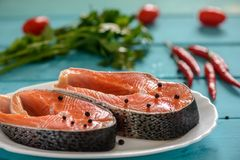Salmon with chili pepper and tomatoes Royalty Free Stock Photography