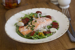 Salmon and chorizo with salad Stock Images
