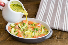 Salmon clafoutis cooking. Wooden background Stock Photography
