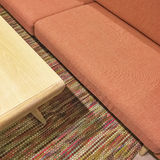 Salmon color sofa and wooden coffee table. Living room detail stock photos