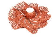 Salmon Colored Crocheted Doily con el gancho de ganchillo foto de archivo libre de regalías