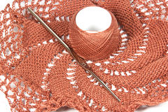Salmon Colored Doily in Process of Being Crocheted Stock Photography