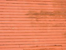 Salmon colored wooden wall to an abandoned building stock photos