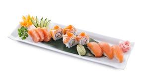 Salmon combo maki. Delicious salmon maki sushi isolated on white background royalty free stock image