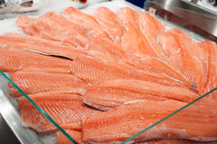 Salmon on cooled market display Royalty Free Stock Photos