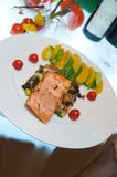 Salmon with corn salsa and tomatoes Stock Photography