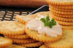 Salmon cream cheese on crackers Stock Images