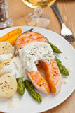 Salmon with creamy asparagus sauce Stock Images