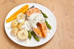 Salmon with creamy asparagus sauce Royalty Free Stock Photos