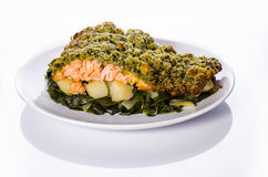 Salmon with crispy crust, potatoes and chard. A tasty homemade meal, very healthy and delicious Royalty Free Stock Images