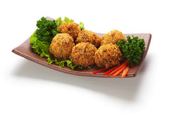 Salmon Croquette. Deep Fried Salmon Croquette. Garnished on Salad Leaf with Bell Pepper and Parsley Royalty Free Stock Photography