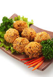 Salmon Croquette. Deep Fried Salmon Croquette. Garnished on Salad Leaf with Bell Pepper and Parsley Stock Image