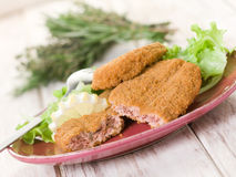 Salmon croquettes with  salad Stock Image