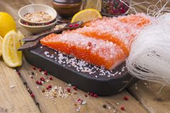 Salmon and crystal noodles. Preparing Thai food. Tasty and healthy. Seafood. royalty free stock photography