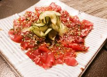 Salmon and cucumber sashimi. Japanese cuisine at its finest Royalty Free Stock Images