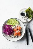 Salmon cucumber wild rice red cabbage leaves nori buddha bowl. Top View. Salmon cucumber wild rice red cabbage leaves nori buddha bowl. Top View Royalty Free Stock Photo