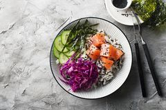 Salmon cucumber wild rice red cabbage leaves nori buddha bowl. Top View. Salmon cucumber wild rice red cabbage leaves nori buddha bowl. Top View Stock Photography