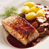 Salmon with currant sauce. Salmon with black currant sauce, mushrooms and potatoes Royalty Free Stock Photos