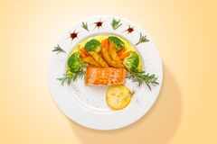 Salmon with curry sauce and fresh vegetables. Top view royalty free stock photography