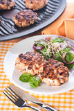 Salmon cutlet with a salad of spinach and onion Royalty Free Stock Photo