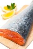 Salmon on cutting board Royalty Free Stock Photos